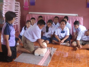 SwimSafe teaches children how to save their peers as well - Grade 5 learning CPR in Chiang Rai province.