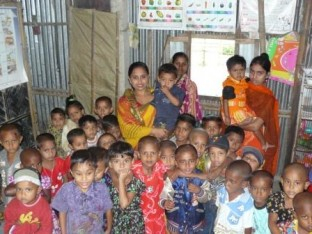 Anchal mother with her students at a creche in Manohardi, Bangladesh