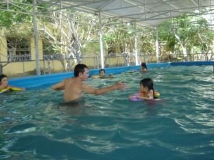 Water familiarisation in one of Danang's 10 portable pools