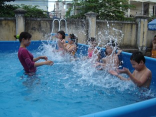 Kids becoming familiar with the water in Danang