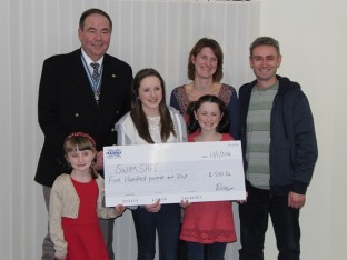 Preece family present funds to Commonwealth Lifesaving